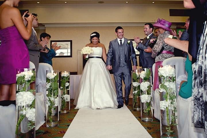 Groom and bride walk down aisle