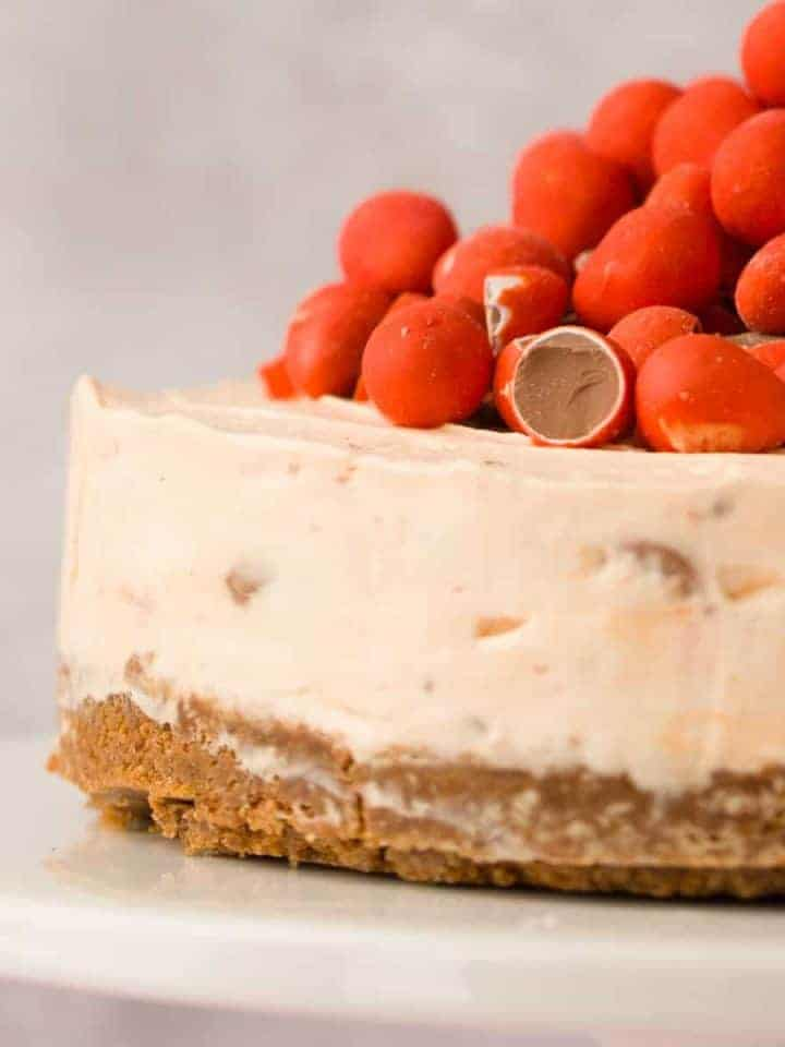 Mini egg cheesecake on a white platter.