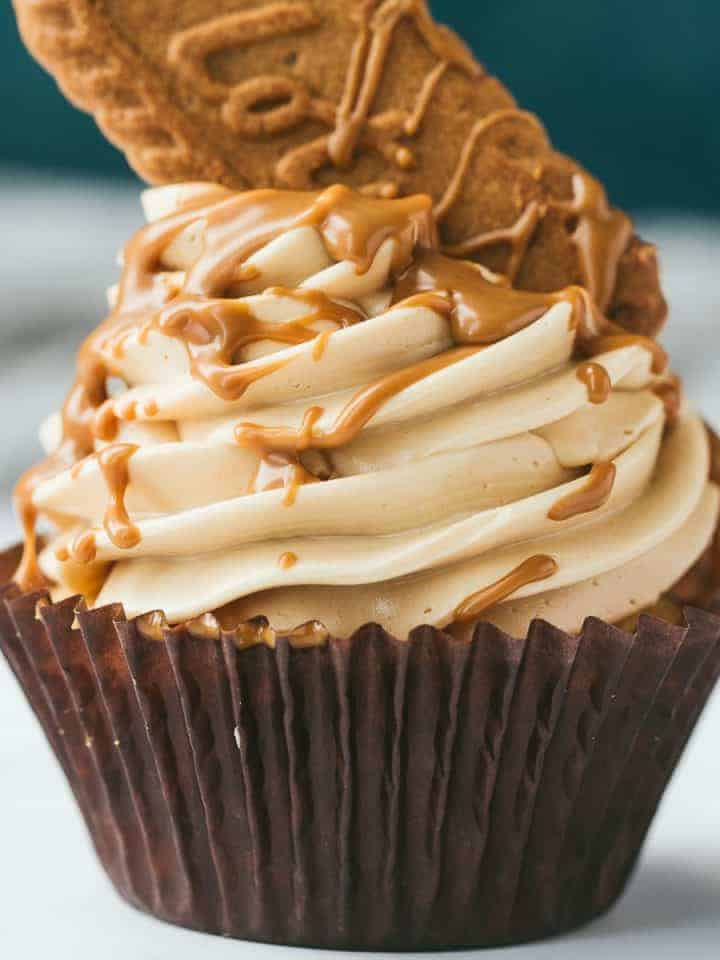 A vanilla cupcake topped with a Lotus biscoff swiss meringue buttercream and drizzled with warm biscoff spread.