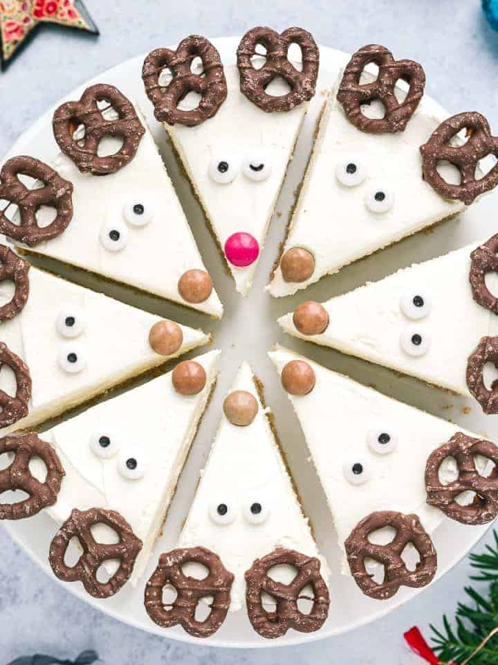 A cheesecake cut into 8 slices and decorated as Reindeer.