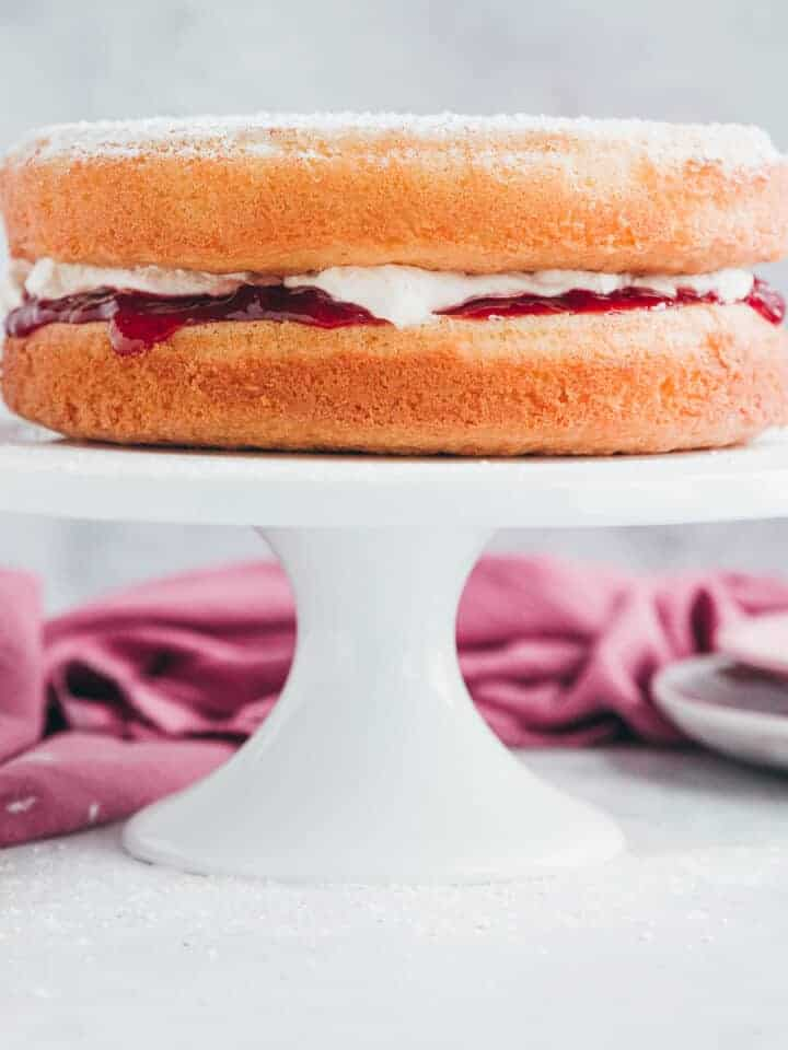 A victoria sponge with a fresh cream and strawberry jam filling.