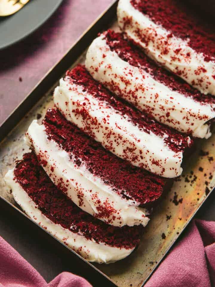 Red Velvet Loaf Cake cut into slices.