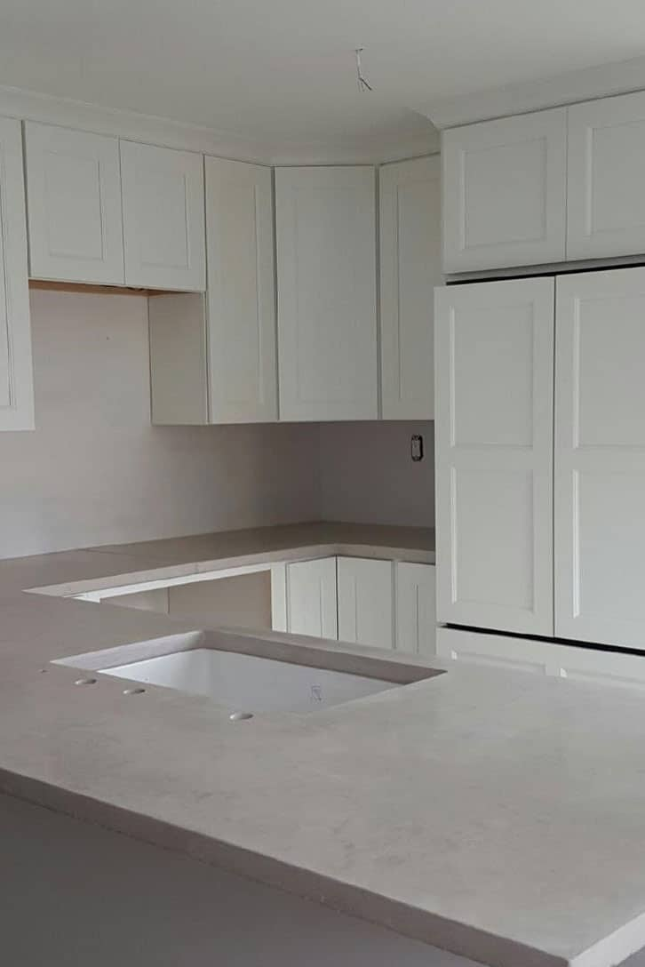 Trowel Finish Concrete Countertops in a white kitchen after install