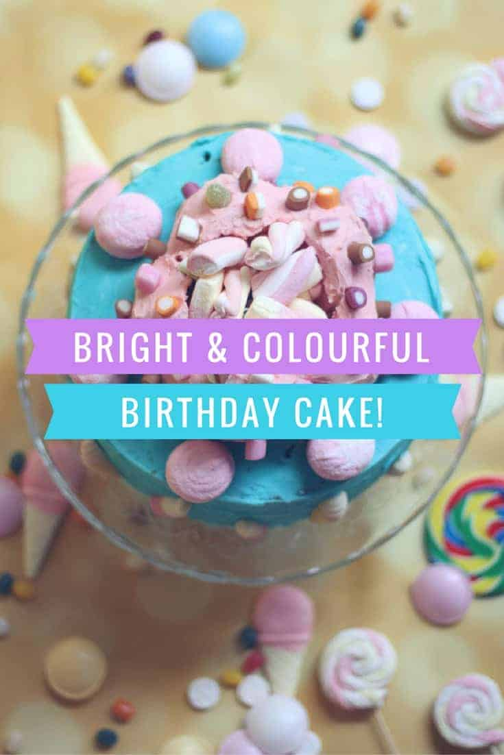 A bright and colourful birthday cake perfect for a children's party centrepiece. Easy to make with two sponges sandwiched together and a ring of iced cupcakes and Pic 'n' mix sweets to decorate!