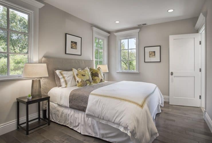 grey and white bedroom with corn yellow accents