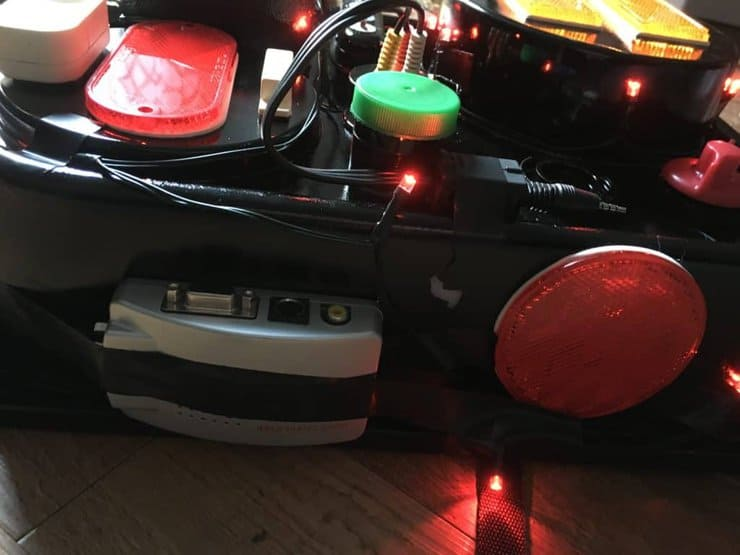 proton pack up close with lights flashing