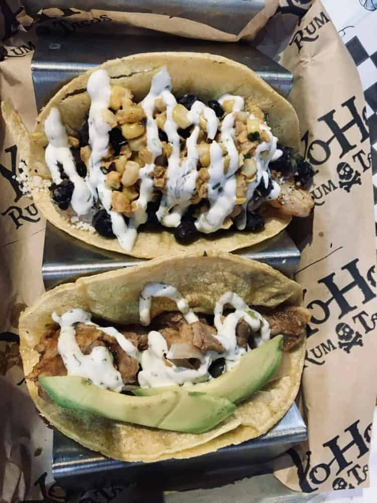 two of the menu tacos on the menu at Yoho Rum & Tacos.