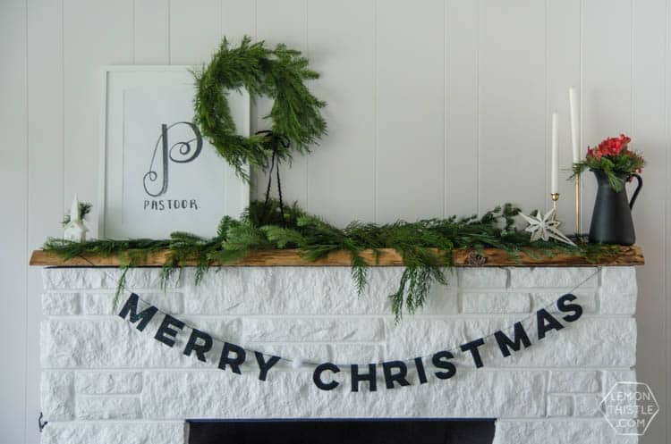 merry christmas banner hanging from fireplace