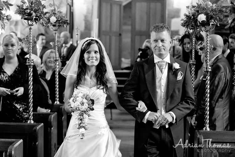 Dad walking his daughter down aisle