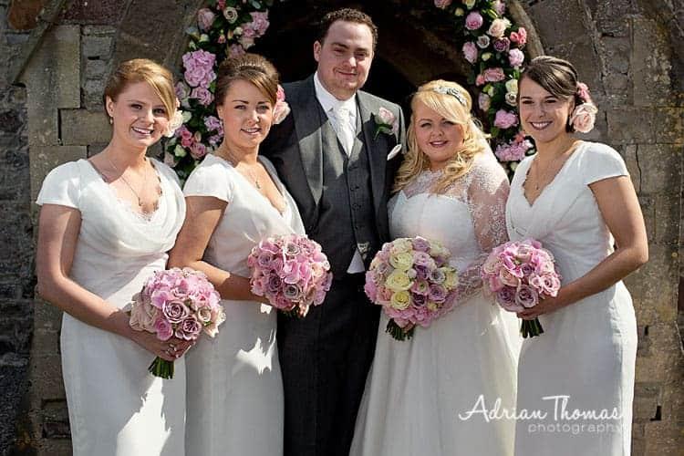 Bride, groom and bridesmaids at church