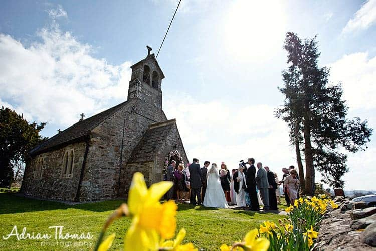 Guests congratulate bride and groom at St Bridget's Church after service