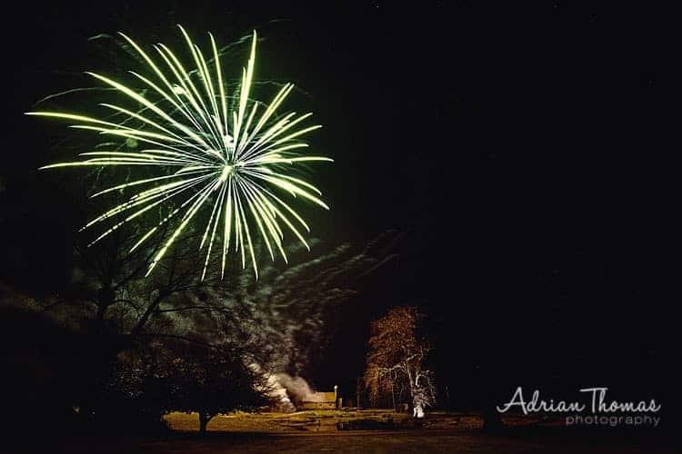 Photograph of fireworks over St Bridgets Church from Llansantffraed Court Hotel Wedding
