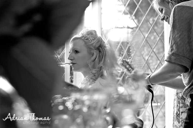 Bride with hairdresser