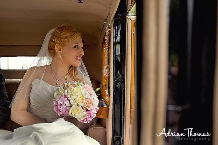 Bride in car outside church