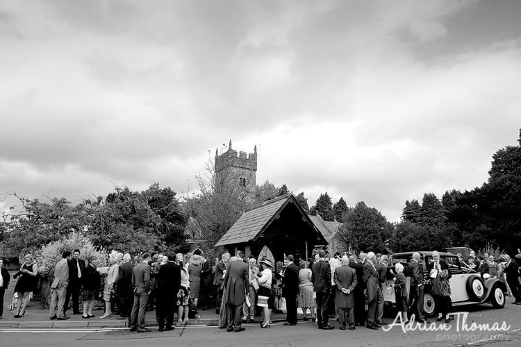 All guest outside St Isans Church in LLanishen with wedding car