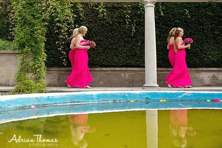 Bridesmaids walking through gardens
