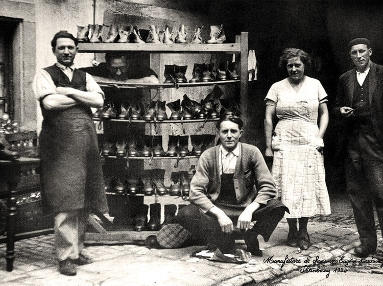 A pic from the newly opened factory in 1934, with Eugene and his wife Madeleine Heschung in the middle. Picture: Heschung