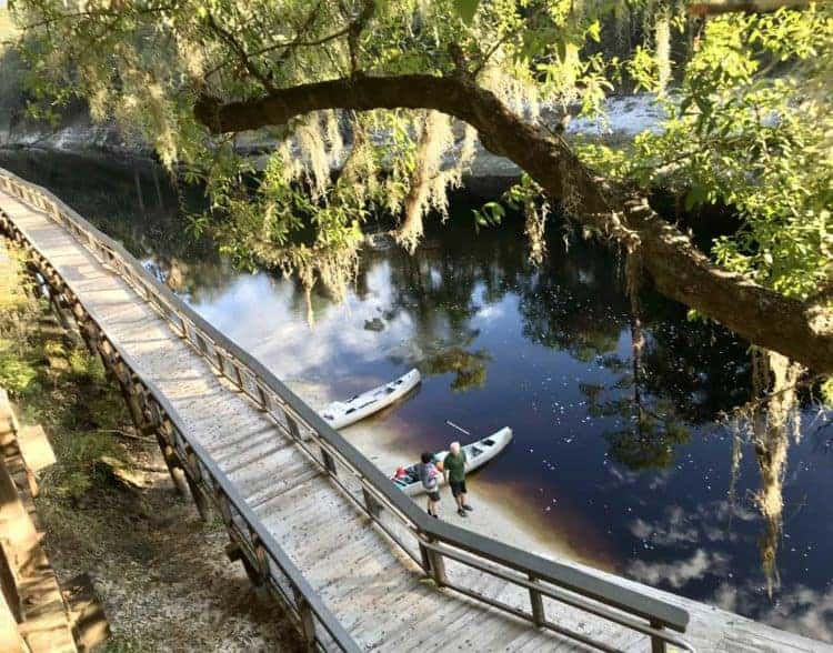 Suwanee River camping: Wooden ramp and river view from the bluff at the Woods Ferry River Camp along the Suwannee River (Photo: Bonnie Gross)