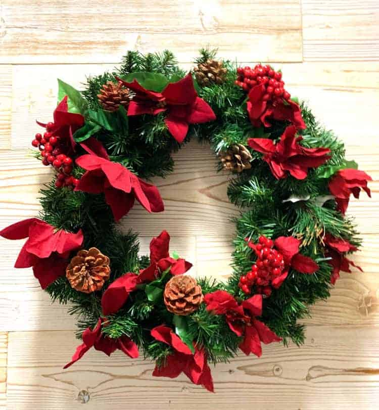 Christmas wreath on wood plank wall
