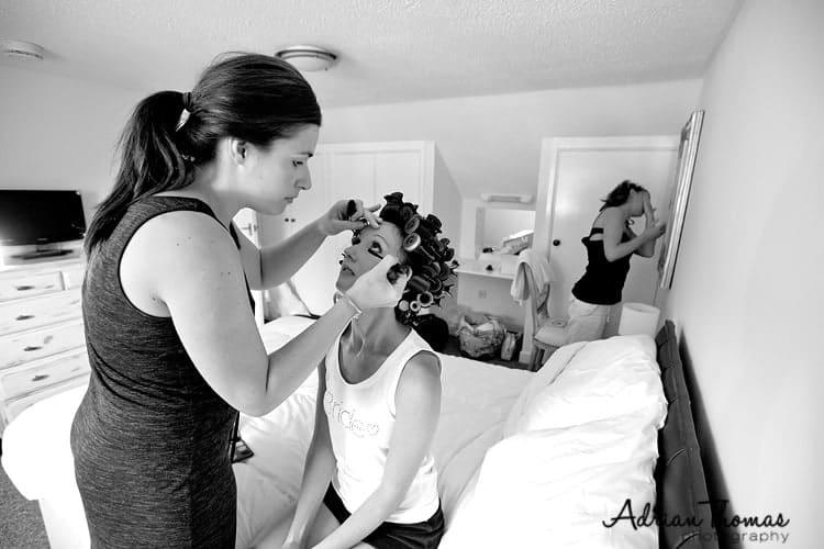 Bride having eyeliner applied by MUA
