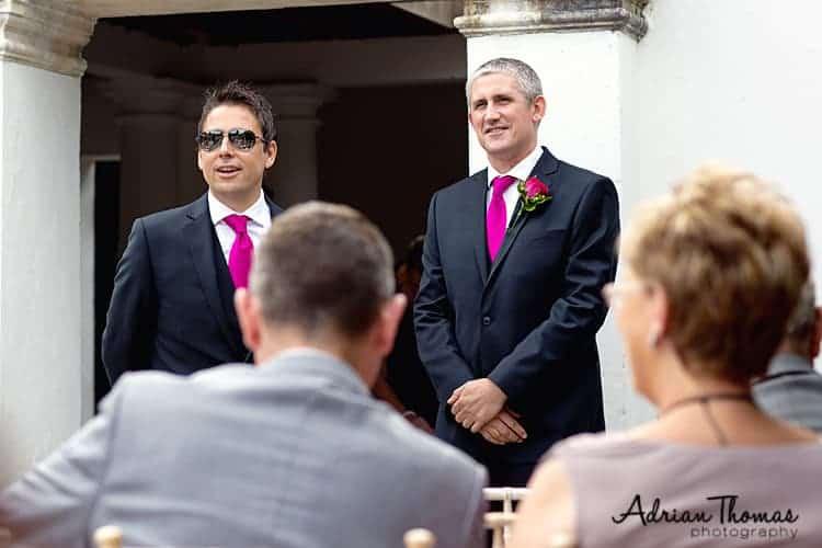 Groom and best man await bride at Llanerch Vineyard wedding