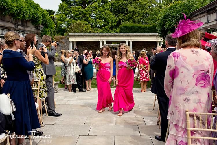 Bridesmaids arriving for ceremony at Dyffryn Gardens
