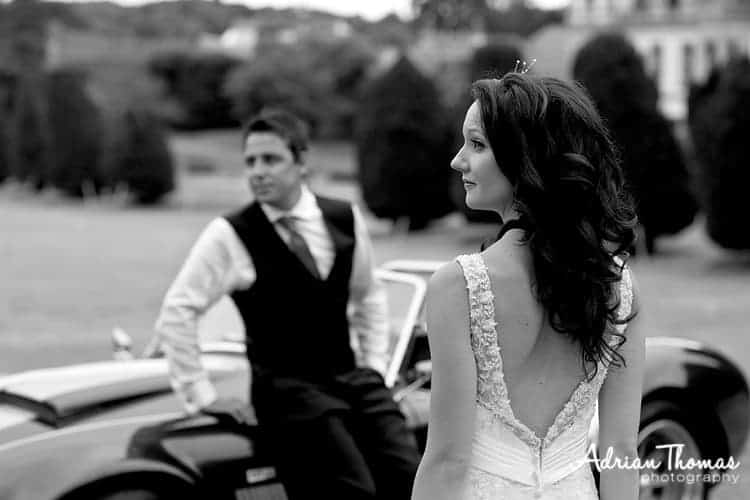 Bride with car and groom