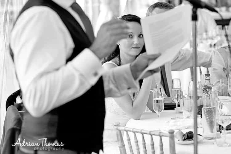 Bride watching groom talk