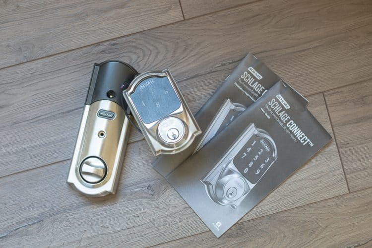 Schlage Connect out of box with instruction manual and user manual on farmhouse plank flooring