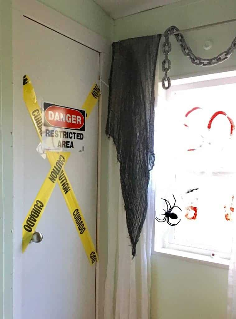 caution tape and danger signs up in a bathroom