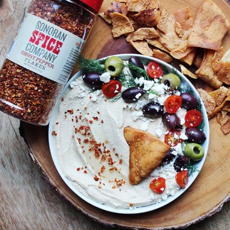 Mediterranean hummus plate using sonoran spice ghost pepper flakes