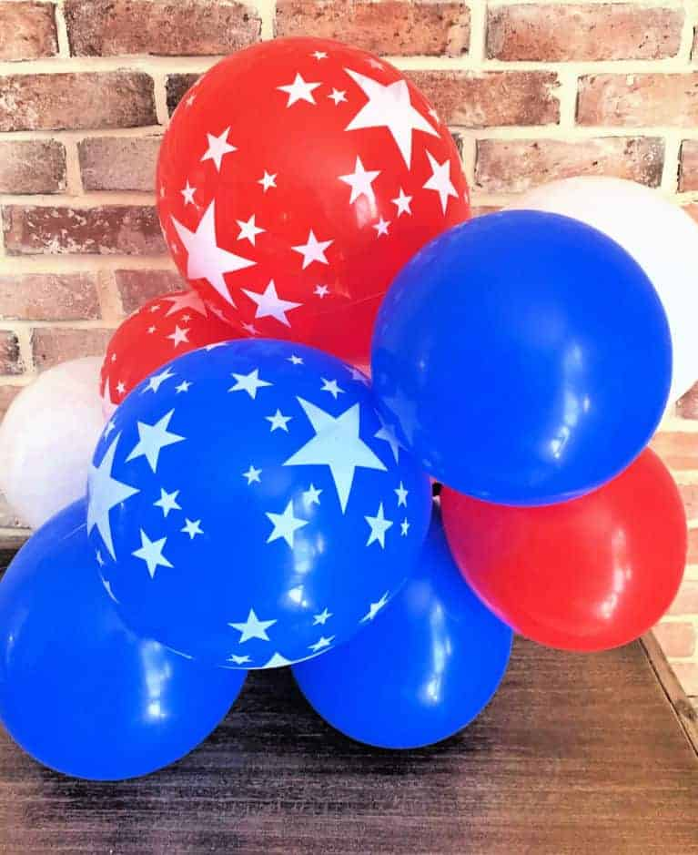 red white and blue balloons in a clump