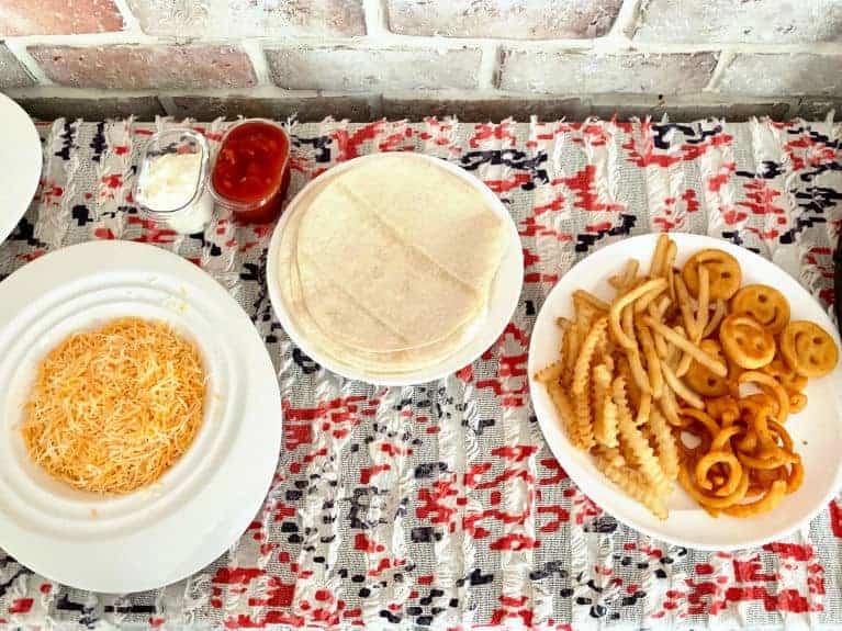 burrito bar toppings on table