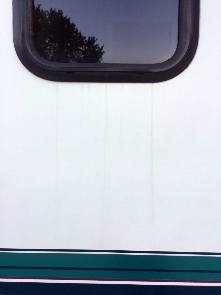 rv black streak cleaner side window before