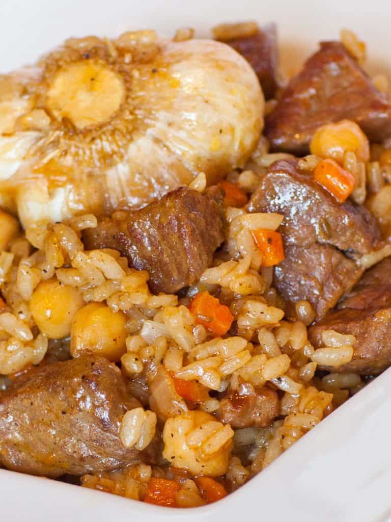 traditional beef plov with garlic and garbanzo beans