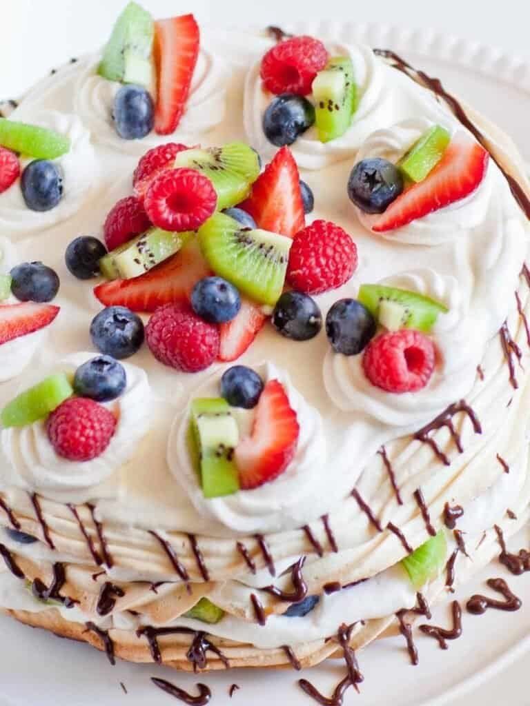 pavlova cake with berries and whipped cream