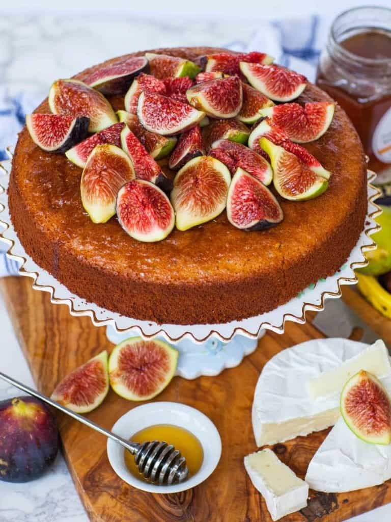 fig and honey cake topped with fresh figs, with honey and brie cheese