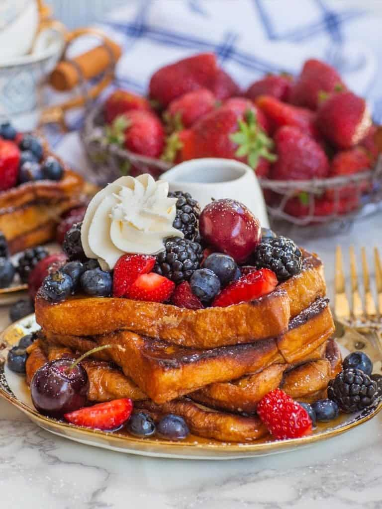 best french toast recipe with brioche bread, berries and cream