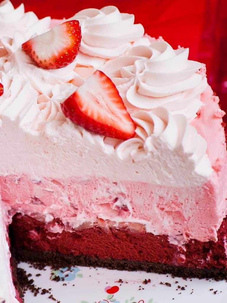triple layered strawberry cheesecake with whipped cream