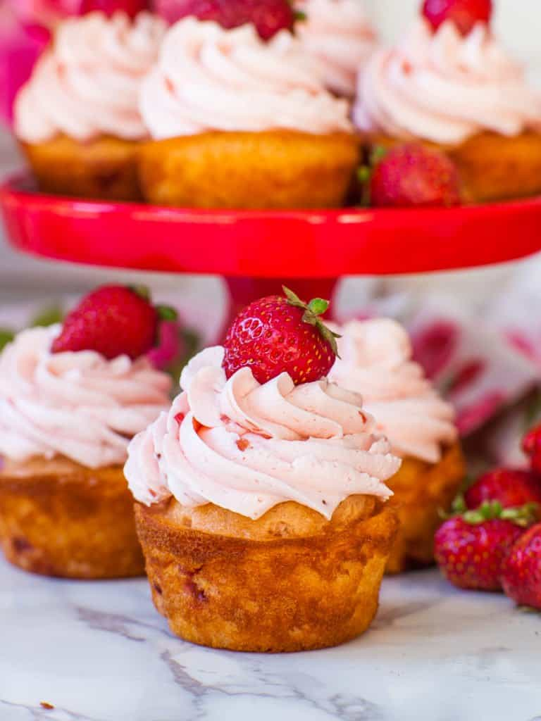 strawberry cupcakes topped with strawberry buttercream
