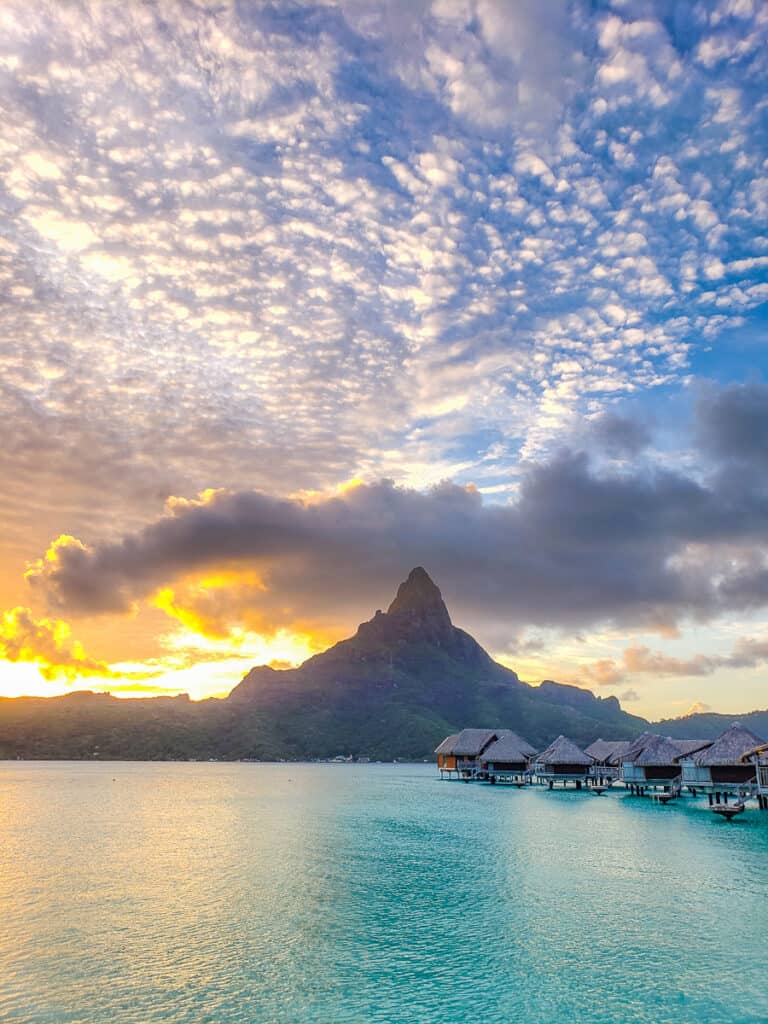 sunset over Mt. Otemanu with overwater bungalows