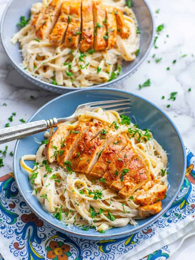 chicken fettuccine alfredo with sliced chicken breast