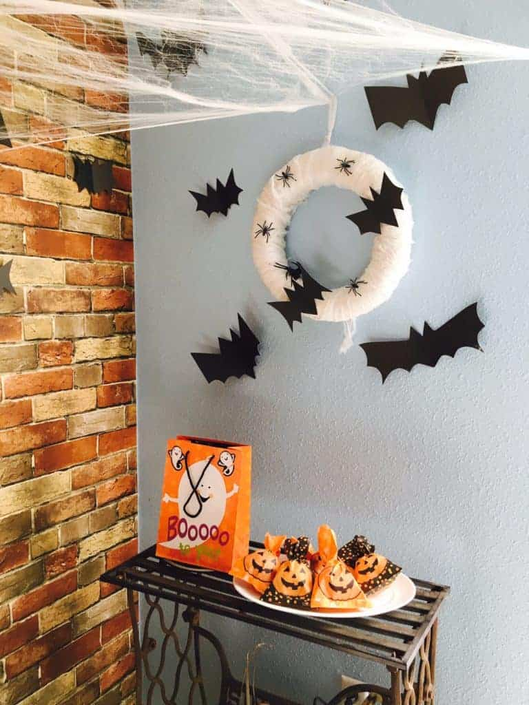 wreath with paper bats hung up on a wall