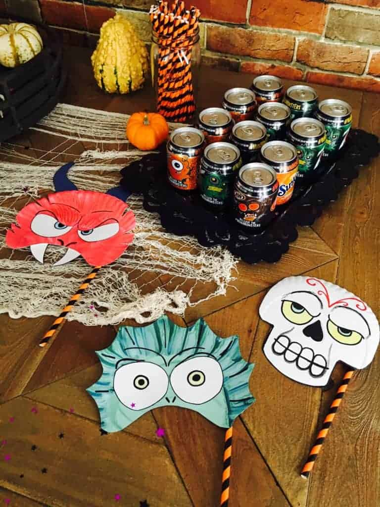 soda and part masks laid out for a party