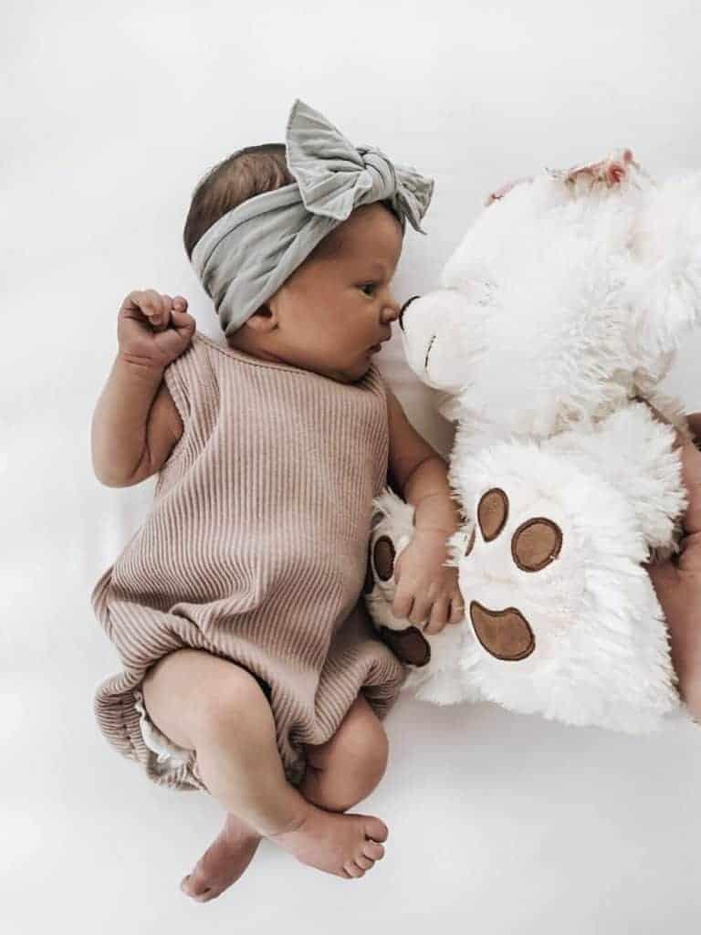 Newborn with a cute toy