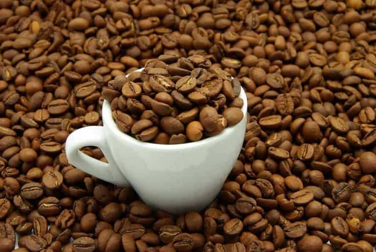 Coffee beans in a cup of coffee