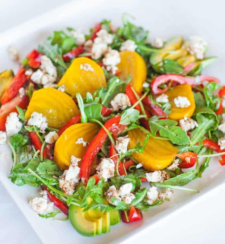 yellow beet salad with arugula, feta and peppers, dressed with balsamic vinaigrette