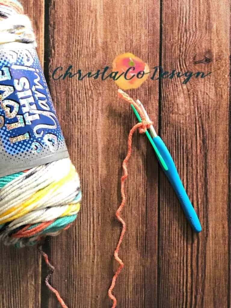 picture of yarn, hook and needle for triangle scarf
