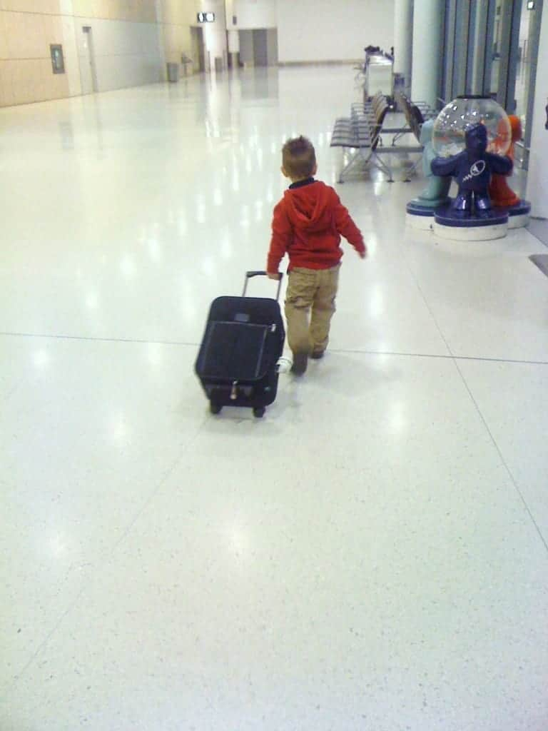flying with a toddler, toddler, airport, suitcase, family travel, travel with toddler, traveling toddlers