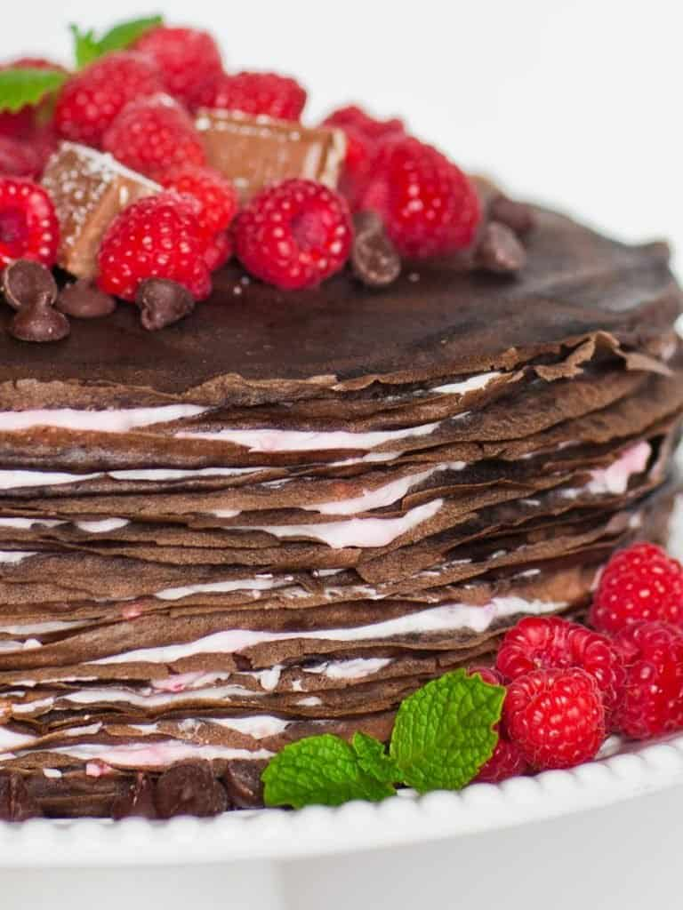 chocolate crepe cake recipe with raspberries and mint
